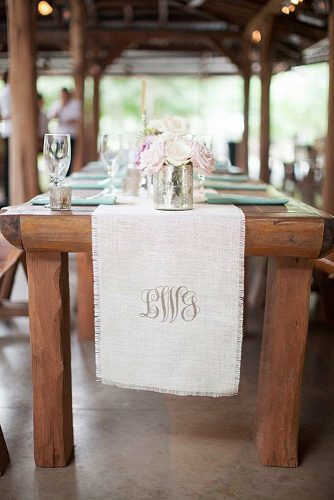 wedding monogram on a wooden table a linen cloth with a monogram kelly hornberger