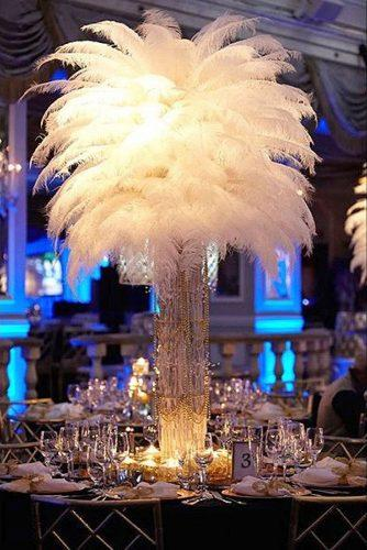 non floral wedding centerpieces lush white feathers in a high crystal vase rebecca weiss photography