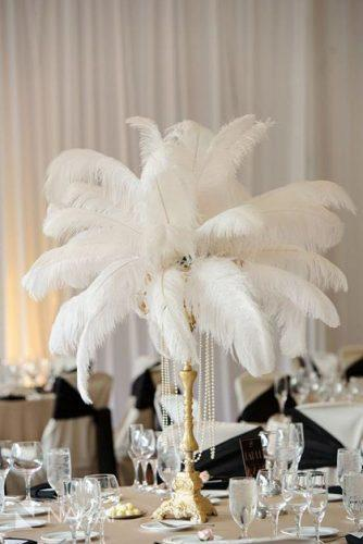 non floral wedding centerpieces on the golden stand white feathers and pearls nakai photography
