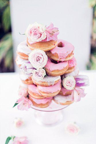 wedding cake alternatives doughnuts tower with pink icing and roses sarah bentley via instagram