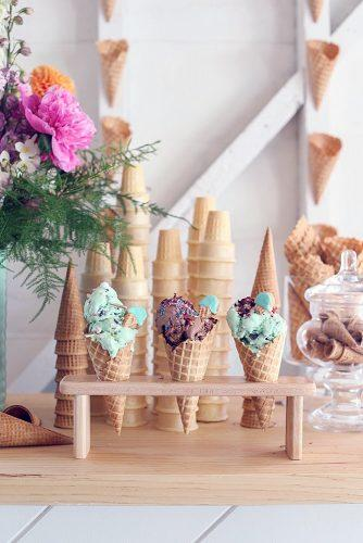 wedding cake alternatives ice cream mint and chocolate in waffle cones on a stand on a background of pink peony flower table dine by deborah shearer via instagram