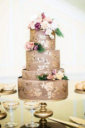 textured wedding cakes beige with golden texture decorated with flowers the mae company via instagram