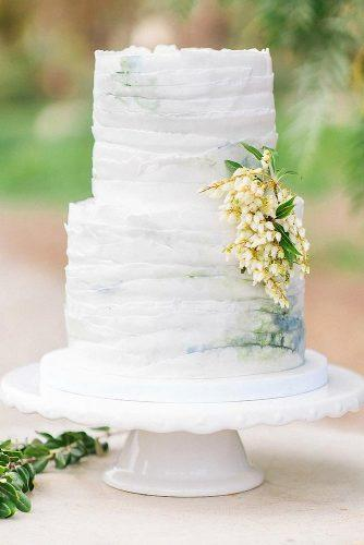 textured wedding cakes cake covered with ruffles with a white flower on a white stand carneros resort and spa via instagram