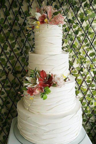 textured wedding cakes cake decorated with flowers fatima santos via instagram