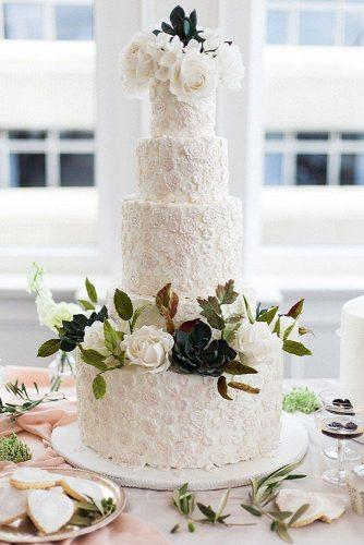 textured wedding cakes high white with patterns and white roses elizabeth solaru wedding cakes via instagram