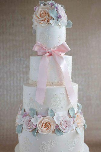 textured wedding cakes high white with patterns pink bow and roses fatima santos via instagram