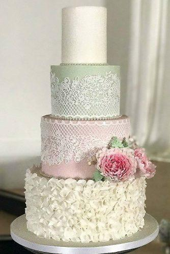 textured wedding cakes in pastel colors with lace and petals decorated with flowers fatima santos via instagram