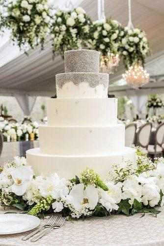 textured wedding cakes tall white covered with a silvery texture surrounded by flowers inside weddings via instagram