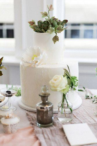 textured wedding cakes white with flowers and herbs with lace texture elizabeth solaru wedding cakes via instagram