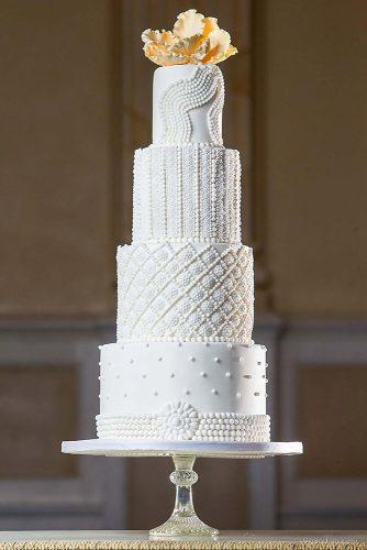 textured wedding cakes with a complex structure high with flowers at the top elizabeth solaru wedding cakes via instagram