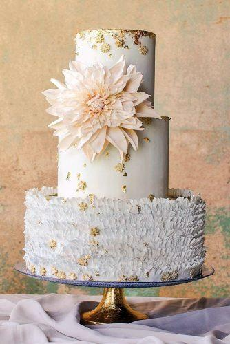 textured wedding cakes with ruffles pink flower and golden accents maggie austin via instagram