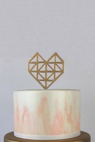 mini wedding cakes marble beige with pink and golden heart on top charm city cakes via instagram