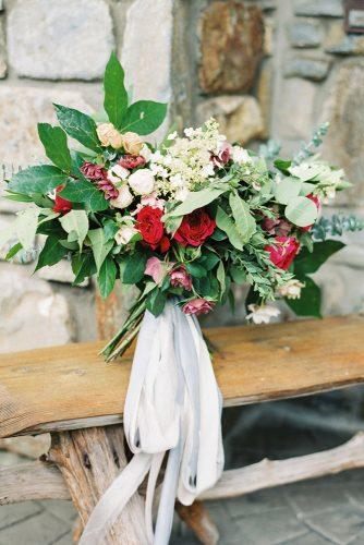 rustic wedding bouquet with0red0flower white tape codyhunterphotography