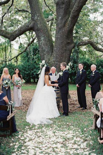 rustic wedding ceremony near tree laurenpeelephotography
