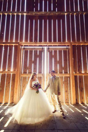 rustic wedding couple near gate adriencraven