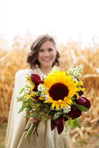 sunflower wedding bouquets with maroon leaves