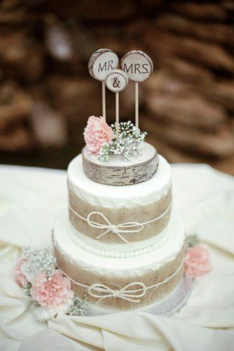 small rustic wedding cakes burlap with flowers and wooden slice on top kate wenzel photography