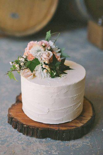 small rustic wedding cakes buttercream with flowers on wood slice kat schultz via instagram