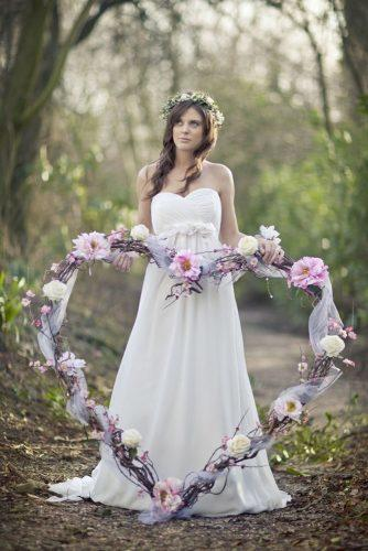 heart wedding photos bride with floral heart in a wood mark tattersall photography