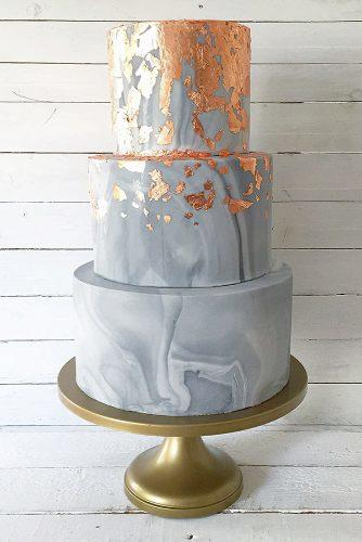 marble-wedding-cakes-three-tiered-dark-cake-with-golden-divorces-on-a-golden-plate-wedspire-via-instagram