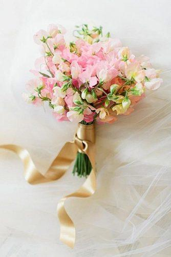 popular-wedding-flowers-small-bridal-bouquet-of-sweet-peas-erin-kate-photo