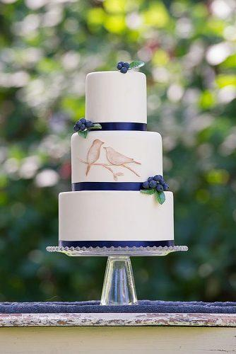 unique wedding cakes simple white three tier cake with blueberries and cute birds erica o brien cake design