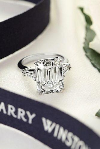 three stone emerald cut diamond rings 4