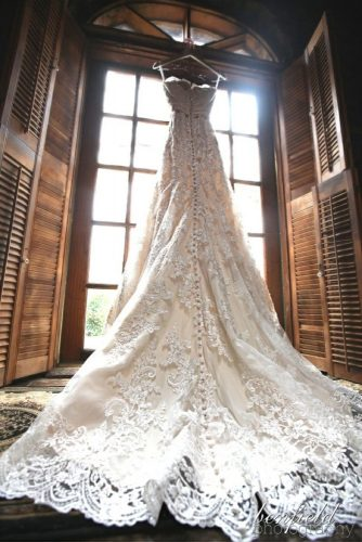 hanging wedding dress long tail back view benfield photography