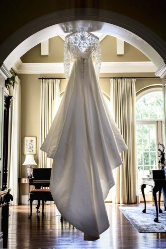 hanging wedding dress long tail back view elena mitchell photography