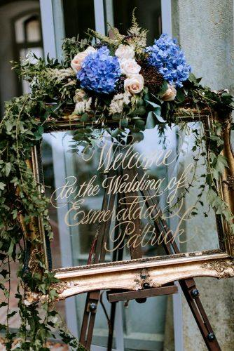 mirror wedding idea wedding sign with blue flower and greenery