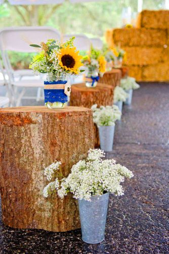 sunflower wedding decor ideas aisle with stumps jessegilesphotography
