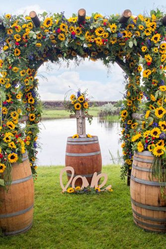 sunflower wedding decor ideas arch near water erica shurter