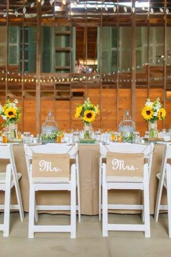 sunflower wedding decor ideas table and white chairs katienesbittphotography