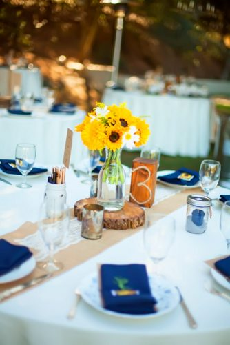 sunflower wedding decor ideas table witn blue napkins jillianhogan