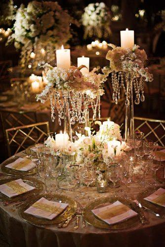 wedding centerpieces tall with white roses and greens and candles crystals gruber photographers