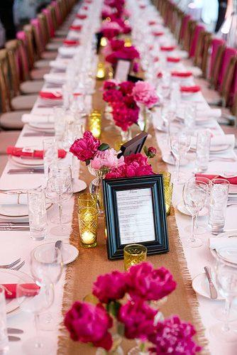 wedding centerpieces with crimson rose peonies and warm candles matt blum photography