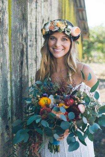 wedding photo shoot bride in flowers with bouquet morgan ashley photography
