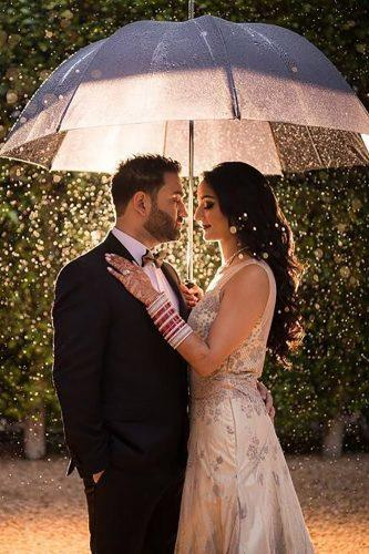 wedding photographers couple under umbrella linandjirsa