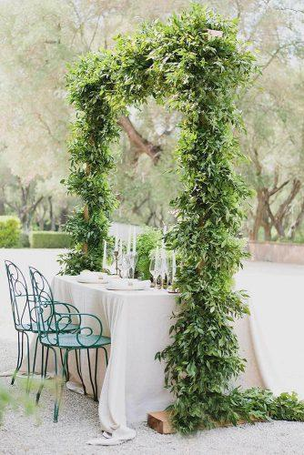 wedding receptions table decorated with greenery arch purewhite_photography via instagram