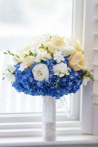 bridesmaid wedding bouquets blue flowers and creamy white roses shoreshotz photography