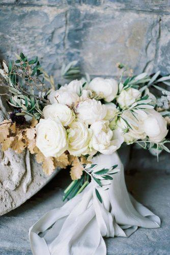bridesmaid wedding bouquets with creamy white roses and peonies wirh greenery katiegrantphoto
