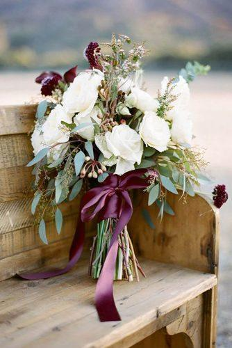 bridesmaid wedding bouquets with white flowers greenery and purple ribbons lmarie photography