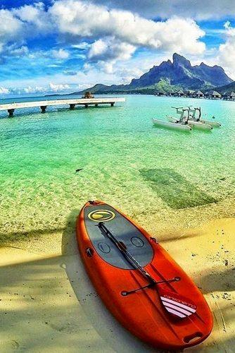 best adventure honeymoon spots red kayak on the beautiful beach in bora bora good