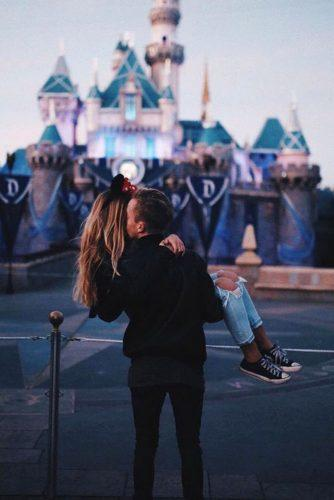 best disney honeymoon in usa kissing near walt disney gate