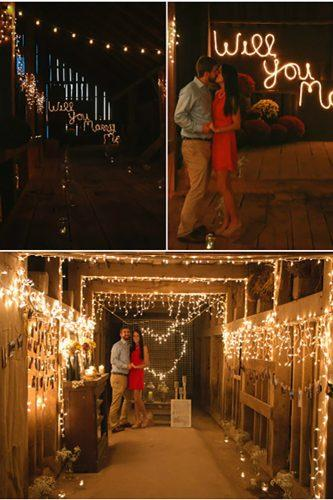 romantic marriage proposal in the barn with candles