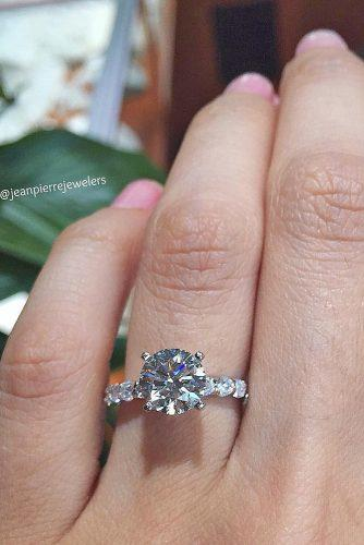 round white gold engagement ring with pave band by jean pierre jewelers