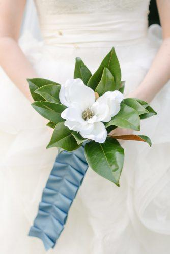 single bloom wedding bouquets magnolia blue tape Caroline Joy Photography