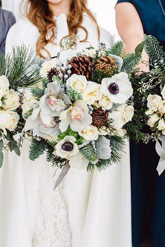 winter wedding bouquets from white flowers with pine cones and branches jessica casperson photo via instagram