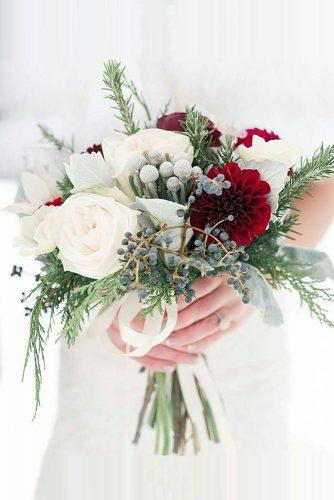 winter wedding bouquets small with white roses red dahlias, black berries of viburnum and spruce branches cedars flower via instagram