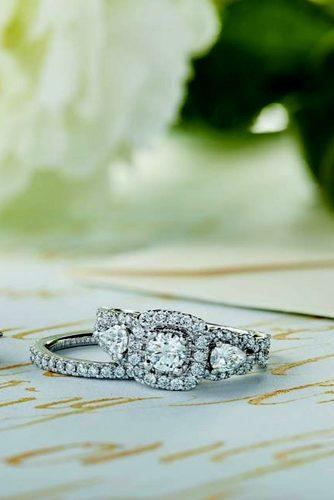 zales engagement rings on the table with white flowers